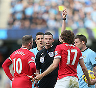 Daley Blind of Manchester United receives a yellow card - Barclays Premier League - Manchester City vs Manchester Utd - Etihad Stadium - Manchester - England - 2nd November 2014  - Picture David Klein/Sportimage