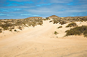 Inland sand dune landscape with unsealed sandy dirt roads La Isla Graciosa, Lanzarote, Canary Islands, Spain