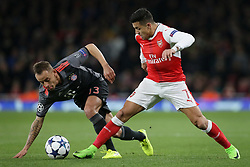 LONDON, March 8, 2017  Rafinha(L) of Bayern Munich vies with Alexis Sanchez of Arsenal during the UEFA Champions League Round of 16 second leg match between Arsenal and Bayern Munich in London, Britain on March 7, 2017. Bayern Munich won 5-1 and advanced to the quarterfinal with 10-2 on aggregate.   wll) (Credit Image: © Tim Ireland/Xinhua via ZUMA Wire)