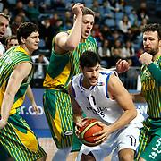 Anadolu Efes's Cenk Akyol (C) during their Turkish Basketball League match Anadolu Efes between Olin Edirne at Arena in Istanbul, Turkey, Saturday, February 11, 2012. Photo by TURKPIX