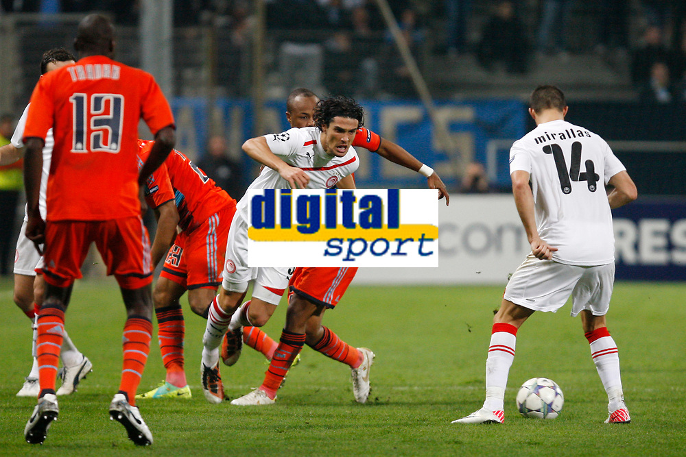 FOOTBALL - UEFA CHAMPIONS LEAGUE 2011/2012 - GROUP STAGE - GROUP F - OLYMPIQUE MARSEILLE v OLYMPIACOS - 23/11/2011 - PHOTO PHILIPPE LAURENSON / DPPI - FRANCOIS MODESTO / KEVIN MIRALLAS (OLY) / ANDRE AYEW (OM)