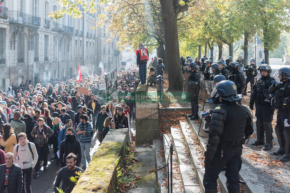 October 9, 2018 - Nantes, France - Several thousand people took part in an interprofessional demonstration in Nantes, France, on 9 October 2018 answering the national call of the unions, to oppose the policy of the government and against its attacks on the world of work, the unemployment allowance, pensions or access to university. Two protesters were arrested. (Credit Image: © Estelle Ruiz/NurPhoto via ZUMA Press)