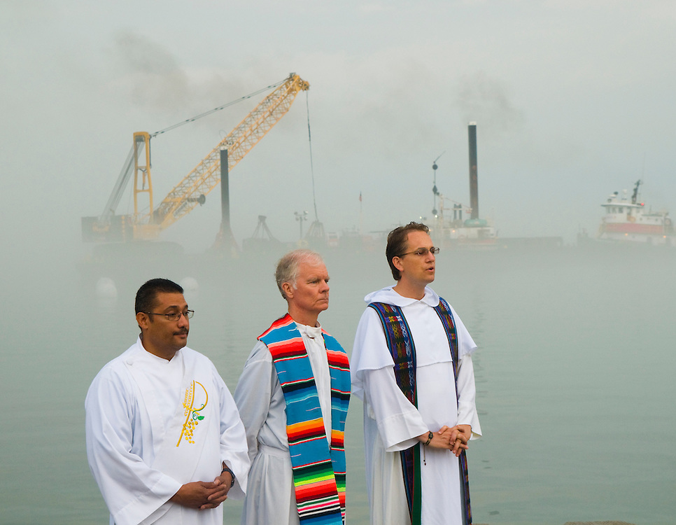 Chicago Catholics are gathered near the 31st St. Beach in Chicago for a Back to School Sunrise Mass to pray for a successful and non-violent school year The event is being held simultaneously on five different Chicago beaches along Lake Michigan.