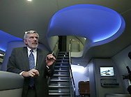 Klaus Brauer, Boeing's director of passenger satisfaction and revenue with the stairway of the mockup of a 747-8 Intercontinental behind. (AP Photo/John Froschauer)