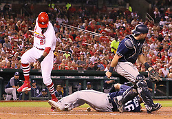 August 22, 2017 - St Louis, MO, USA - The St. Louis Cardinals' Dexter Fowler (25) scores on a wild pitch by San Diego Padres pitcher Jhoulys Chacin (46), who tries to cover home with catcher Austin Hedges in the fifth inning on Tuesday, Aug. 22, 2017, at Busch Stadium in St. Louis. (Credit Image: © Chris Lee/TNS via ZUMA Wire)