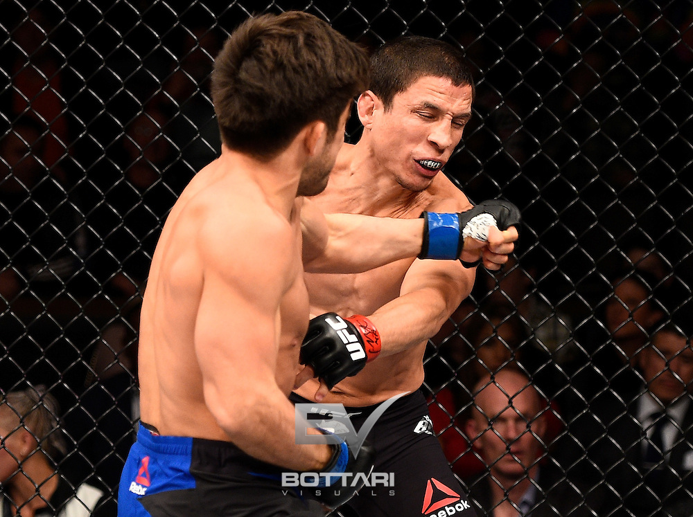 LAS VEGAS, NV - DECEMBER 03:  (L-R) Henry Cejudo punches Joseph Benavidez in their flyweight bout during The Ultimate Fighter Finale event inside the Pearl concert theater at the Palms Resort & Casino on December 3, 2016 in Las Vegas, Nevada. (Photo by Jeff Bottari/Zuffa LLC/Zuffa LLC via Getty Images)