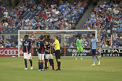 August 20, 2017 - New York, New York, United States - Referee Mark Geiger speaks to Benjamin Angoua (4) of New England Revolution during regular MLS game against NYC FC on Yankee stadium NYC FC won 2 - 1  (Credit Image: © Lev Radin/Pacific Press via ZUMA Wire)