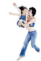 beautiful woman playing with her little girl on studio white background