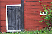 Traditional style Swedish wooden painted house. Black door. Smaland region. Sweden, Europe.