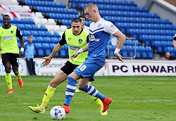 Peterborough United's Marcus Maddison in action with Oldham Athletic's Mike Jones - Photo mandatory by-line: Joe Dent/JMP - Mobile: 07966 386802 - 04/10/2014 - SPORT - Football - Peterborough - London Road Stadium - Peterborough United v Oldham Athletic - Sky Bet League One