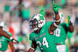 Oct 9, 2021; Huntington, West Virginia, USA; Marshall Thundering Herd linebacker Eli Neal (24) celebrates following a defensive stop during the first overtime to end the game and defeat the Old Dominion Monarchs at Joan C. Edwards Stadium. Mandatory Credit: Ben Queen-USA TODAY Sports