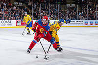 KELOWNA, BC - DECEMBER 18:  Pontus Holmberg #29 of Team Sweden stick checks Evgenii Kalabushkin #3 of Team Russia at Prospera Place on December 18, 2018 in Kelowna, Canada. (Photo by Marissa Baecker/Getty Images)***Local Caption***