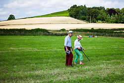 © Licensed to London News Pictures.12/08/15<br /> Danby, UK. <br /> <br /> A couple walk across a field as they visit the 155th Danby Agricultural Show in the Esk Valley in North Yorkshire. <br /> <br /> The popular agricultural show attracts competitors and visitors from all over the surrounding area to this annual showcase of country life. <br /> <br /> Photo credit : Ian Forsyth/LNP