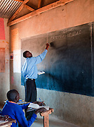 School teacher in classroom at Iloileri School near Amboseli National Park, Rift Valley Province, Kenya