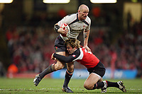 Photo: Rich Eaton.<br /> <br /> Wales v Canada. Invesco Perpetual Series. 17/11/2006. Gareth Thomas left of Wales is tackled by Canadas David Spicer