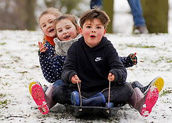 © Licensed to London News Pictures. 02/1/2021. Olly 7, Enna 7 and Nya 6, enjoy sledging in the snow at North Park in Darlington following a heavy snow last night.   Photo credit: Ioannis Alexopoulos/LNP <br /> <br /> **Permission Granted