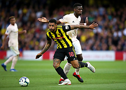 Watford's Andre Gray (left) tackled by Manchester United's Paul Pogba during the Premier League match at Vicarage Road, Watford