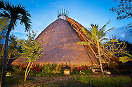 The 10-meter diameter Mandala Agung structure offers a gathering space for large groups. A thick shag of alang alang thatch and a towering plan provide natural cooling.