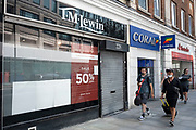 As Britain enters a period of deep recession, some shops remain closed with shutters down either temporarily or permanently as the economic downturn caused by the Covid-19 pandemic cuts hard on the high street as with shops like the shirtmaker TM Lewin 12th August 2020 in London, United Kingdom. The Office for National Statistics / ONS has announced that gross domestic product / GDP, the widest gauge of economic health, fell by 20.4% in the second quarter of the year, compared with the previous quarter. This is the biggest decline since records began. The result is that Britain has officially entered recession, as the UK economy shrank more than any other major economy during the coronavirus outbreak.