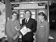 05/01/1989.01/05/1989.5th January 1989.The Aer Lingus Young Scientist of the Year Award at the RDS, Dublin ..Picture shows Michael Smith, T.D., Minister for Energy with John Fitzgerald, CBS, Thurles, Co. Tipperary with his project 'Comic Readership Amongst School Children in Thurles Schools, age group 5-12.' Also pictured is Ann O'Reilly, Aer Lingus.