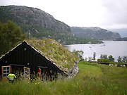Lysefjorden, Forsand, Rogaland, Norway. a local grass coverd house