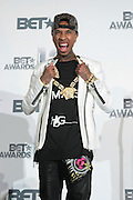 June 30, 2012-Los Angeles, CA : Recording Artist Tyga attend the 2012 BET Awards- Media Room held at the Shrine Auditorium on July 1, 2012 in Los Angeles. The BET Awards were established in 2001 by the Black Entertainment Television network to celebrate African Americans and other minorities in music, acting, sports, and other fields of entertainment over the past year. The awards are presented annually, and they are broadcast live on BET. (Photo by Terrence Jennings)