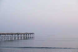 © Licensed to London News Pictures. <br /> 10/04/2015. <br /> <br /> Saltburn, United Kingdom<br /> <br /> Saltburn pier reaches out from the beach at first light.<br /> <br /> Photo credit : Ian Forsyth/LNP