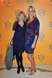 Left to right, DEBBIE MOORE founder of Pinapple Dance Studios and JODIE KIDD at the 38th Veuve Clicquot Business Woman Award held at Claridge's, Brook Street, London W1 on 28th March 2011.