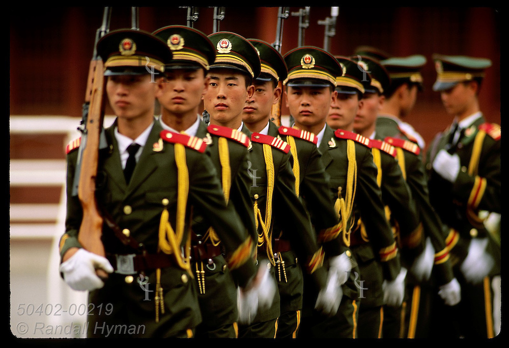 Soldiers march off parade ground after dress inspection outside Forbidden City in Beijing. China