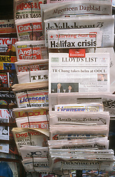 Newspaper stand outside shop,