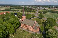 Luftfoto av Vestby kirke, som er en langkirke fra 1886 i Vestby kommune, Søndre Follo prosti i Akershus fylke. Byggverket er i stein og har 450 plasser. Vestby i bakgrunnen.
