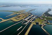 Nederland, Zeeland, Gemeente Schouwen-Duiveland, 01-04-2016; Philipsdam en Krammersluizen. Onderdeel van het compartimenteringswerk waardoor het zoete water van Volkerak (rechtsboven) en het zoute water van het Krammer gescheiden blijft. Midden-rechts de bedieningsgebouwen voor het zoet-zoutscheidingssysteem van de sluizen, de doorlaatwerken.<br /> Het geheel maakt deel uit maken van de Deltawerken.<br /> Philipsdam with Krammersluizen, part of the Delta Works. The locks form a division between sweet and salt water.<br /> <br /> luchtfoto (toeslag op standard tarieven);<br /> aerial photo (additional fee required);<br /> copyright foto/photo Siebe Swart