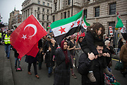 Syria Solidarity Campaign March For Aleppo on December 17th 2016 in London, England, United Kingdom. Protesters gather to demonstrate is support of the people of the Besieged Eastern  town of Aleppo which is on the verge of falling to the Assad regime. Reports estimate about 98% of Eastern Aleppo is now under the control of the Assad regime and its allies. The protest is planned to show anger at the inaction of the international community in the face of catastrophic bombings in Aleppo.