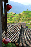 Roofs of Ping An village with rice fields in background. Guangxi, China, Asia