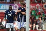 Kieran Dowell of Nottingham Forest (R) celebrates with teammates after scoring his team's fourth goal. EFL Skybet football league championship match, Brentford  v Nottingham Forest at Griffin Park in London on Saturday 12th August 2017.<br /> pic by Steffan Bowen, Andrew Orchard sports photography.