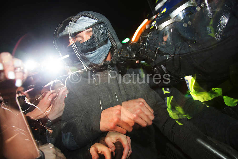 Riot police clash with protesters at a Bonfire Night protest in central London by the activist group Anonymous, in a demonstration called the Million Mask March. Masked protesters created havoc as they marched on Parliament, and all over central London. The protest, which was organised in hundreds of cities, is said to be against austerity and infringement of human rights.