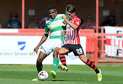 Yeovil Town's Stephen Arthurworrey is tackled by Exeter City's Tom Nichols - Photo mandatory by-line: Harry Trump/JMP - Mobile: 07966 386802 - 08/08/15 - SPORT - FOOTBALL - Sky Bet League Two - Exeter City v Yeovil Town - St James Park, Exeter, England.