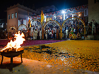 PUSHKAR, INDIA - CIRCA NOVEMBER 2018: Aarti ceremomy in Pushkar during the Camel Fair. It is one of the world's largest camel fairs. Apart from the buying and selling of livestock, it has become an important tourist destination. The city of Pushkar is a pilgrimage site for Hindus and Sikhs.