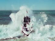 Ackroyd C00504-1. Coast Guard 'Yaquina Bay' riding the waves on Siletz river bar at Taft, Oregon, Now Lincoln City. November 1, 1959.