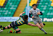 Sale Sharks full back Simon Hammersley breaks past Northampton Saints lock Alex Moon during a Gallagher Premiership Round 13 Rugby Union match, Saturday, Mar. 13, 2021, in Northampton, United Kingdom. (Steve Flynn/Image of Sport)