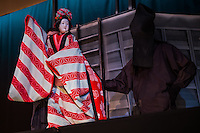 Bunraku is Japanese puppetry that has developed over a period of twelve centuries.  It has long been considered popular entertainment for ordinary people.  It is said to have first been developed by Takemoto Gidayu, the largest contributor to music and dialogue for bunraku puppet plays otherwise known as gidayubushi, which is based on the daily life of merchants in Osaka.  The vivid lives of Osaka merchants made the shows popular with locals, with stories of sorrow and joy, rather than more sophisticated fare.  The skills required of the puppet masters are another element that makes the shows so intriguing.  Bunraku has been inscribed as a UNESCO intangible heritage of Japan.