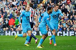 Christian Eriksen (DEN) of Tottenham Hotspur celebrates scoring a late equaliser for a 3-3 result - Photo mandatory by-line: Rogan Thomson/JMP - 07966 386802 - 12/04/2014 - SPORT - FOOTBALL - The Hawthorns Stadium - West Bromwich Albion v Tottenham Hotspur - Barclays Premier League.