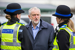 © Licensed to London News Pictures. 15/03/2018. Carlisle UK. Labour Leader Jeremy Corbyn talks to community support officers during a visit to a building site in Carlisle, Cumbria today. Photo credit: Andrew McCaren/LNP