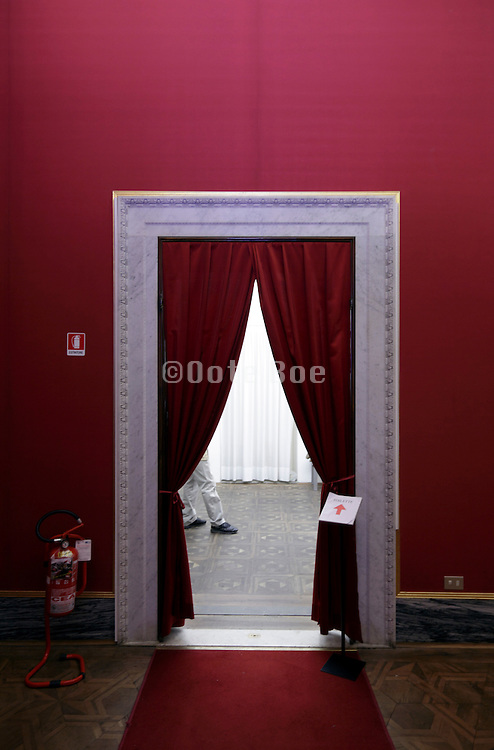 waiting for the toilet behind a classic elegant draped curtain