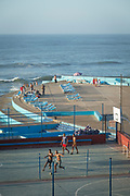 High angle view of people on lido with sea in background, Casablanca, Morocco