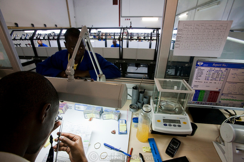 Diamond polishers work on their gems in a diamond polishing factory at NamCot Diamonds in Windhoek, Namibia. Diamonds are one of Namibia's major exports, and  while conflict diamonds grab the headlines, the fact is that the industry does provide a fairly decent living for many.