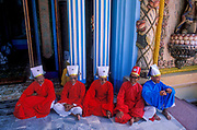 Cao Dai priests at their temple in Tay Ninh, Vietnam