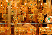 Gold jewels - necklaces, bangles, bracelets and pendants on display at the Gold Souk in Kuwait City, Kuwait