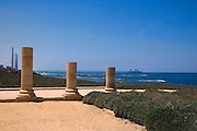 Israel, caesarea, a town built by Herod the Great about 25 - 13 BC, lies on the sea-coast of Israel columns with the modern Hadera coal power plant in the background