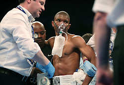 Siboniso Gonya is treated with oxygen after he was knocked out by Zolani Tete in the 11th second of the first round during the WBO Bantamweight Championship of the World at the SSE Arena Belfast.